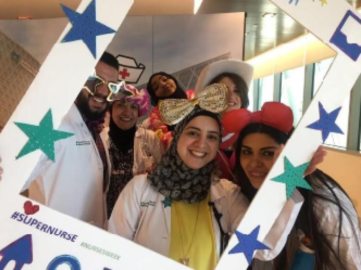 picture of students posing with fun props during nurses week.