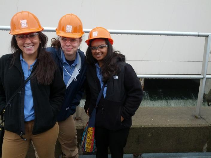 Grad Entry MN students Kristina Barney (left), Abigail Helman, and Sailja Patel stand outside the clean water reservoir during their public health field trip to the Northeast Ohio Sewer District Plant.