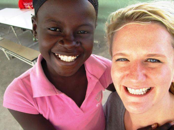 Diana hugging a student in Haiti at a local orphanage.