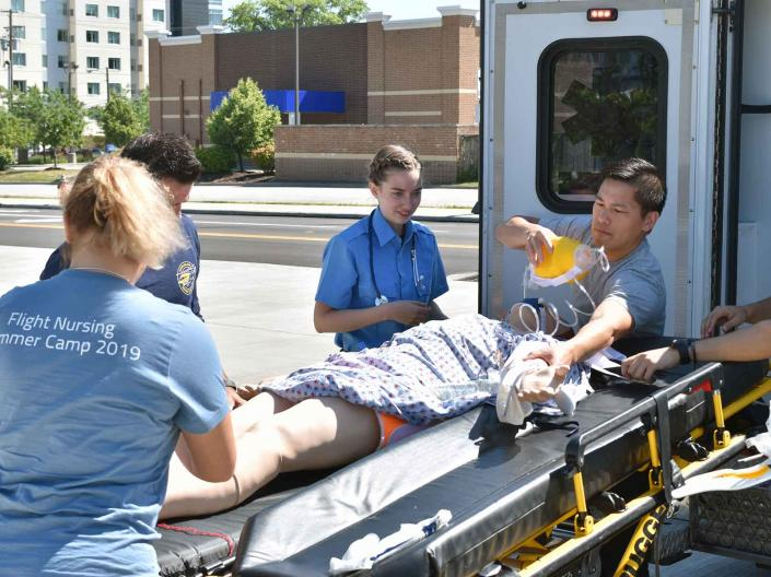 Students in a critical care transport nursing simulation at the 2019 Flight Summer Camp.