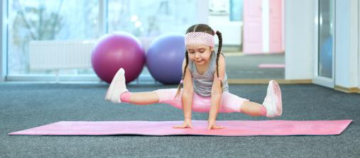 stock image of a young girl exercising