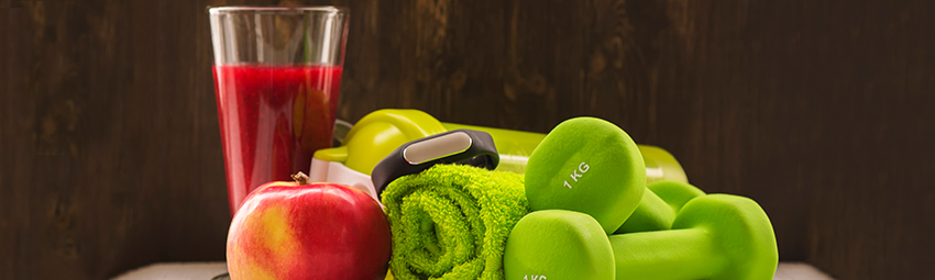 Smoothie, apple, dumbells and a towel