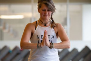 Woman in yoga pose wearing tanktop