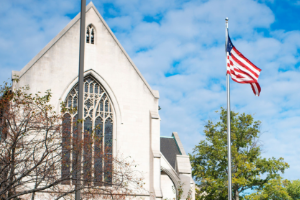 Church with American Flag against blue sky