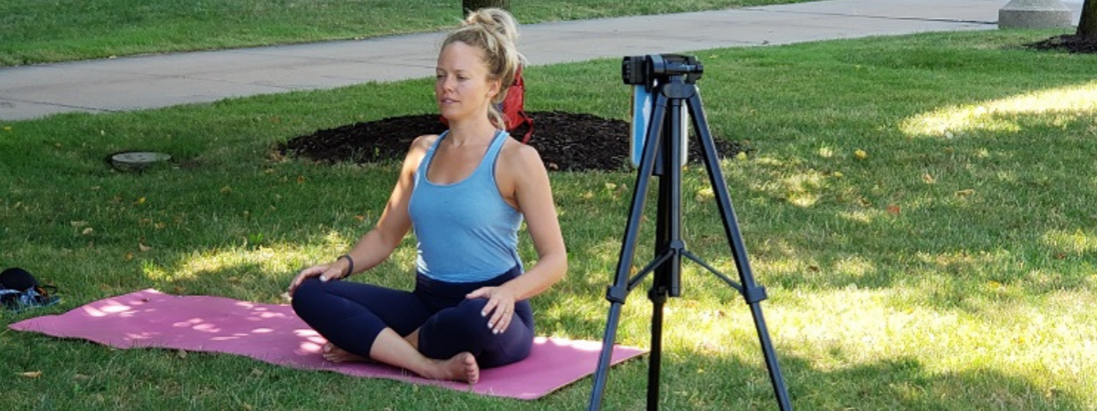 Woman sitting in Yoga pose outside