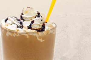 Chocolate Shake with whipped cream and straw