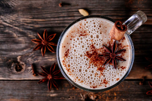 chai tea smoothie with star anise in glass mug