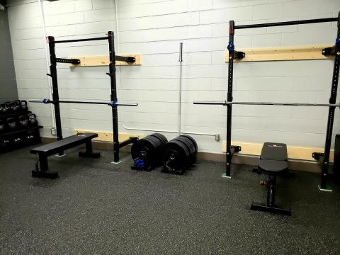 Two exercise barbell racks