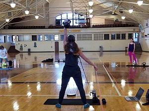 Woman holding kettlebell in a gym