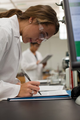 Woman in lab wearing goggles Case Western Reserve University Online Master's Degrees and Certificates in Engineering