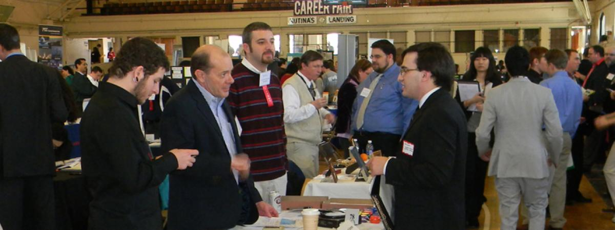 A group of employers and students at a Career Fair