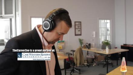 Gordon wearing headphones looking at a desk