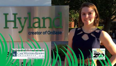 Karen in front of Hyland Software's sign