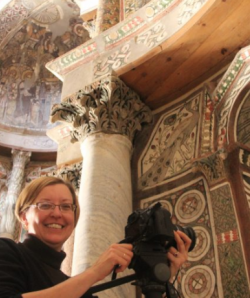 Image of Elizabeth Bolman with camera in church