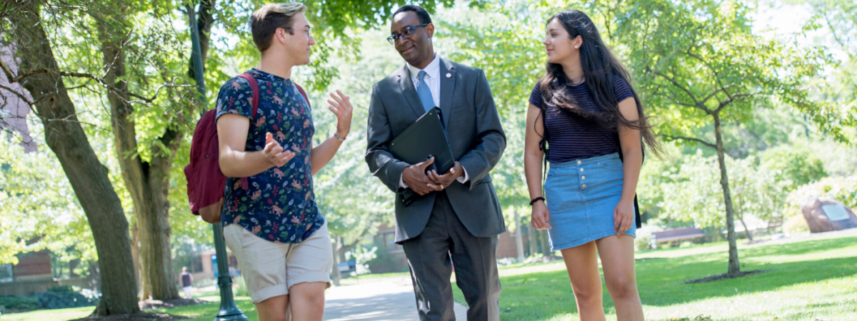 Provost Ben Vinson III walks through campus with a pair of students.