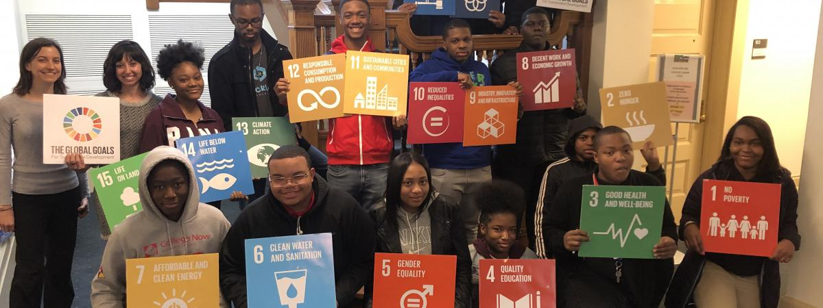 Provost Scholars holding Global Goals
