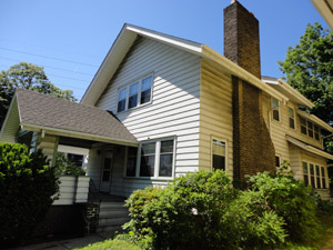 White home with brick chimney in University Circle, Cleveland Ohio