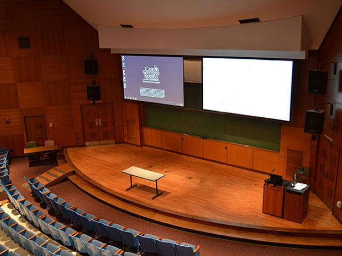 The inside of one of CWRU's rooms with a screen and presentation