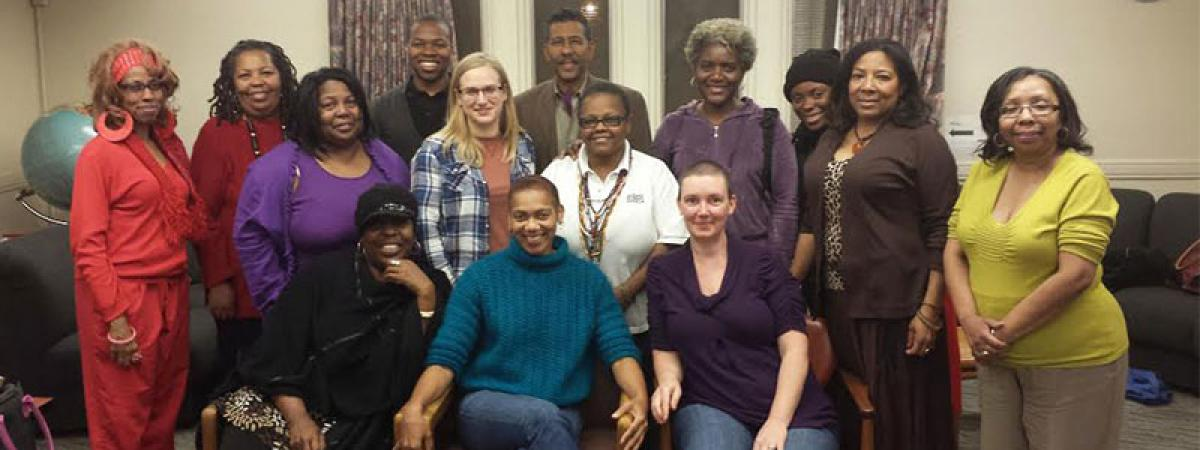 Photo of Voicing + Action Project Community Researchers with Dr. Rhonda Y. Williams