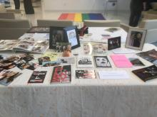 Photograph of exhibit table from Queer Love art installation