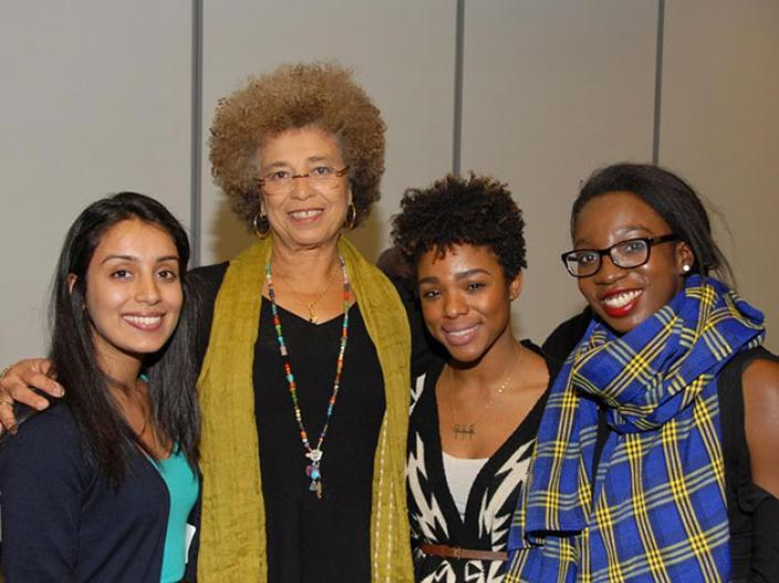 Three women with Angela Davis