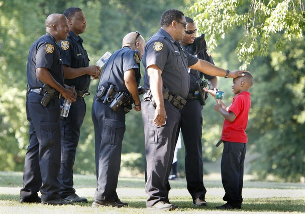 Police officers talking with children