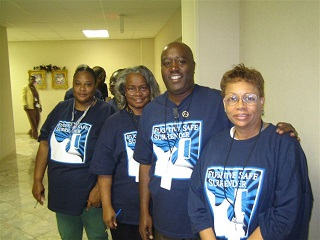 Volunteers standing together in a hallway