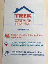 Trek Development logo. Underneath text reads We pledge to: treat everyone with the kingness we all want, do our own part to take care of the place where we live and work, take the time to help each other achieve our goals and aspirations.