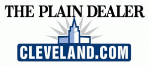 Image of logo with text The Plain Dealer in black, a line image of the terminal tower with a star pattern behind, in blue, white and grey, and cleveland.com in white in blue box