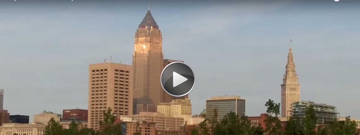 Cleveland skyline with video play button