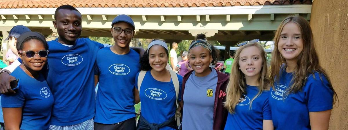 Group of students smile in Change Agent shirts
