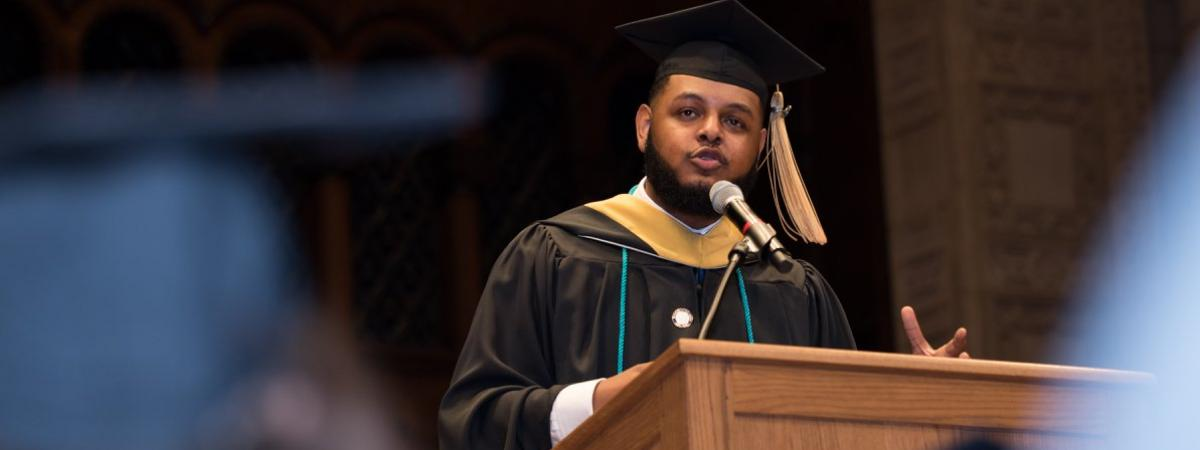 Student delivering speech at graduation