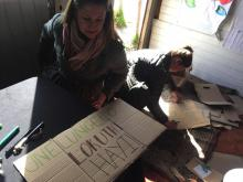 Students creating large hand written signs