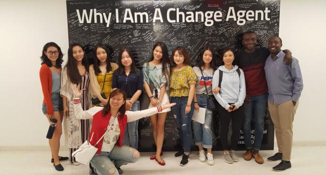 International class in front of the change agent wall