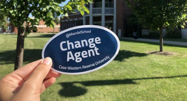 Change Agent sticker in front of building