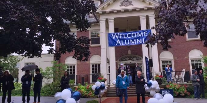 "Exterior of the Alumni House with a banner reading ""Welcome Alumni"""
