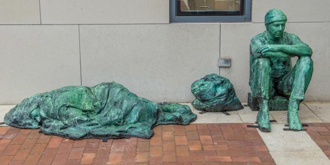 The Homeless sculpture on the steps of the Mandel School