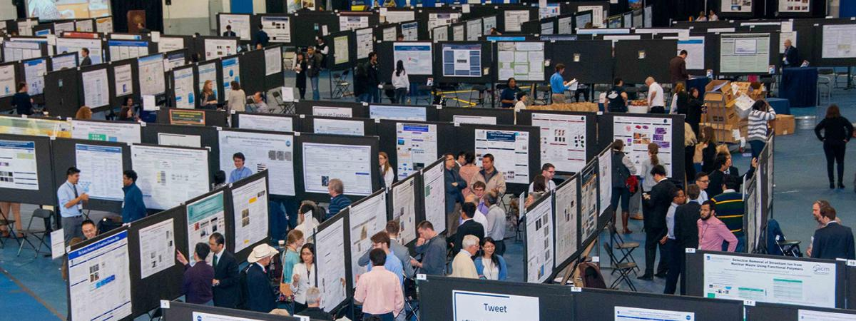 aerial view of intersections with rows of posters and presenters of research