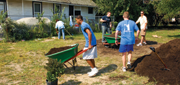 Students complete yardwork as part of a community service project.