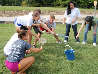 Students participate in outdoor team-building activity on retreat