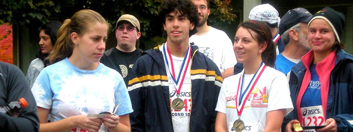 Students wearing medals after finishing a race