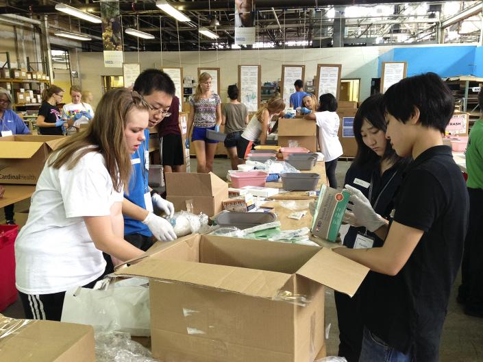 Students packing boxes of medical supplies