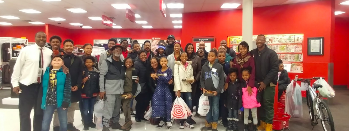 Group of children shopping at Target with Larry Ogunjobi