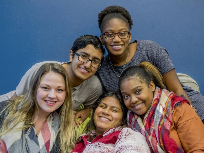 A group of students pose in the Office of Multicultureal Affairs space