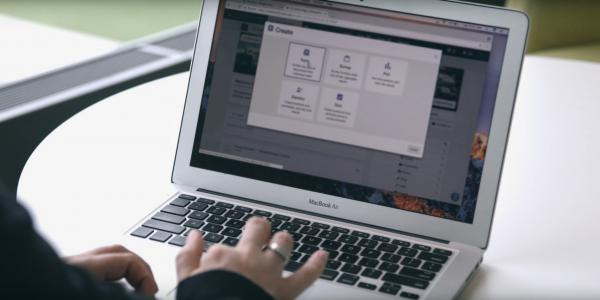 A CampusGroups user creates a new form using a laptop