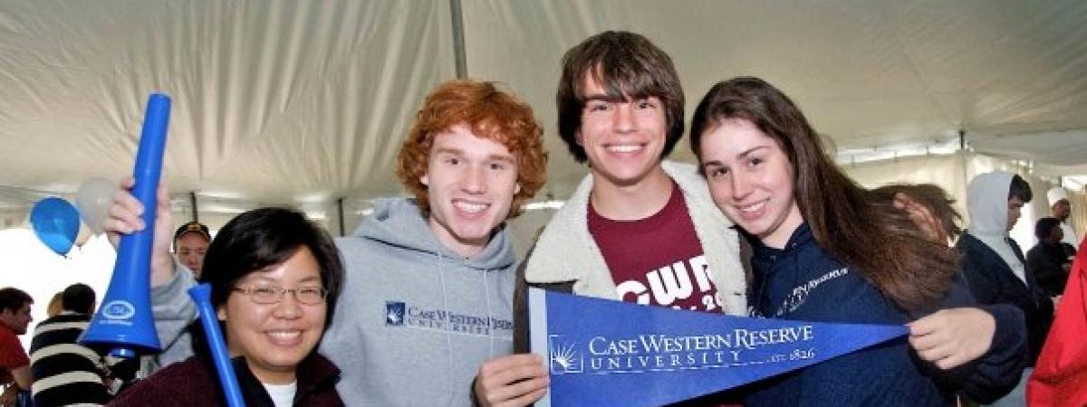 Four first-year students celebrating during orientation