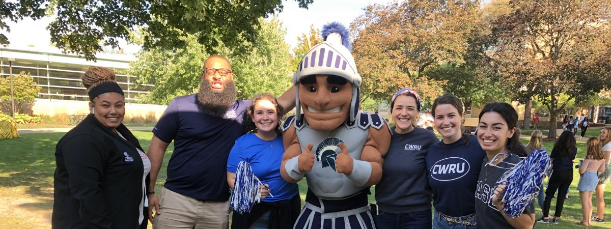 staff posing and smiling with Sparty