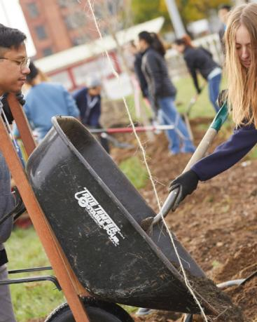Two students helping at a community garden