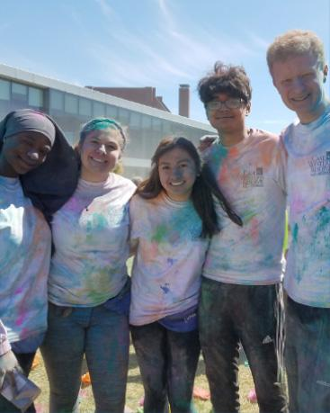 Students participating in the Holi celebration