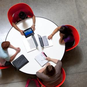 students studying in a group around a table
